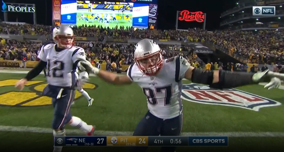 "Brady reminding Gronk that ""It ain't over yet"" after the 2pt conversion"